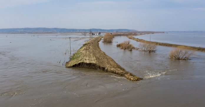 """Learning With: '""""Breaches Everywhere"""": Flooding Bursts Midwest Levees, and Tough Questions Follow'"""