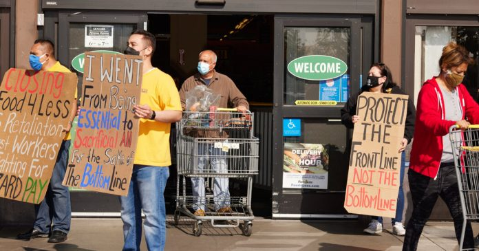 """Lesson of the Day: '''We Are Forgotten"""": Grocery Workers Hope for Higher Pay and Vaccinations'"""